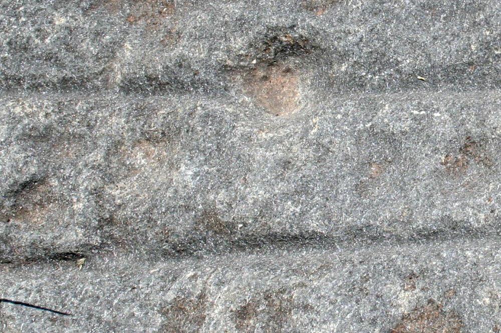 Détail d'une pierre à cupules